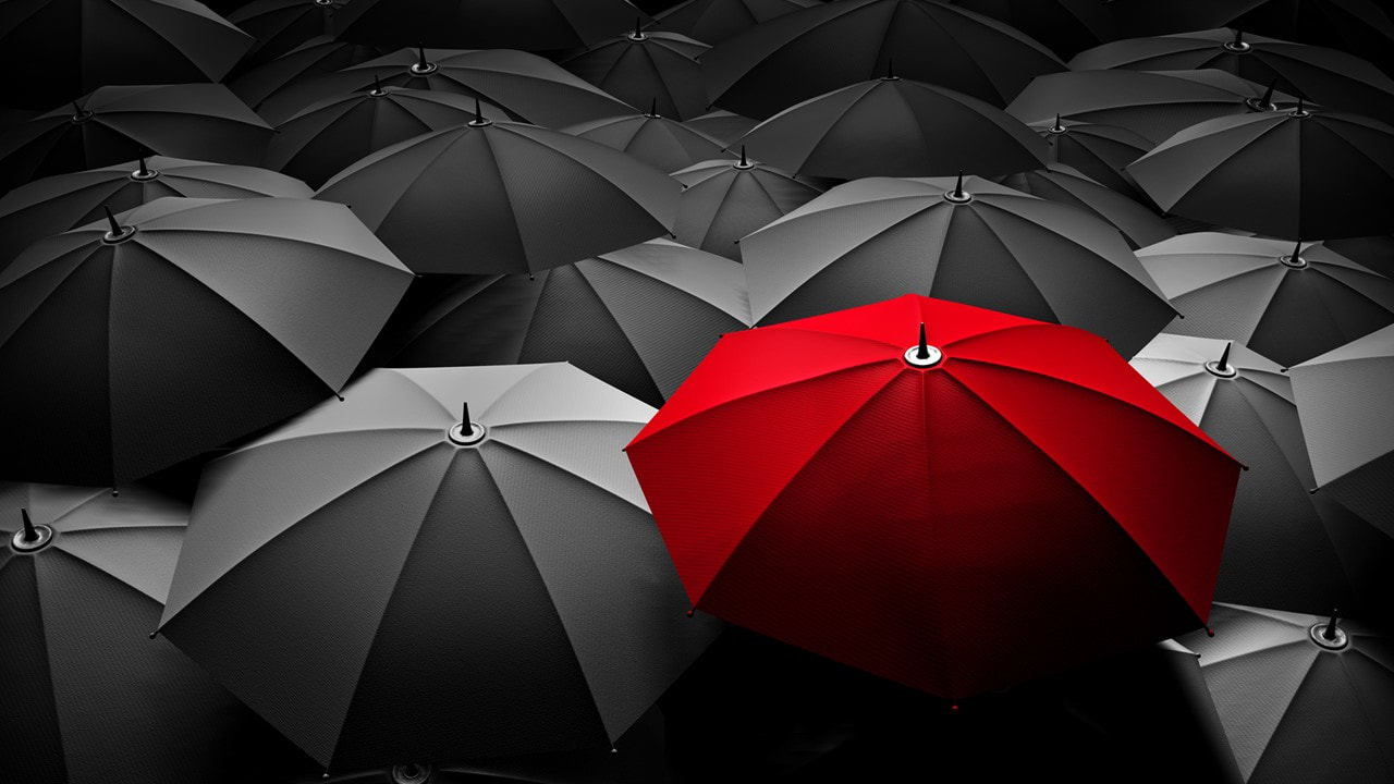 Red Umbrella in a sea of black