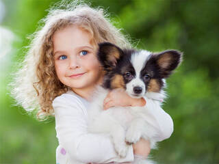 Young girl hugging her puppy